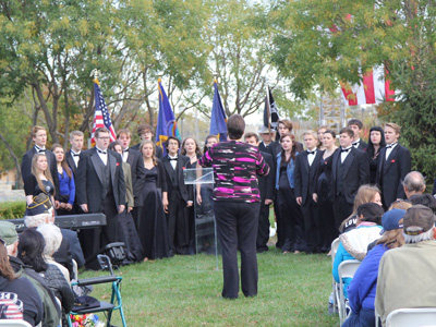 Students from Olathe South High School's Southside Singers honored veterans with patriotic songs