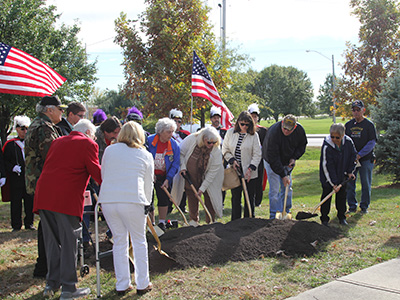 Ground breaking by local Gold Star families for future Gold Star monument in Olathe's Veterans Memorial Park during a special ceremony during the 2016 Veterans Day Observance.