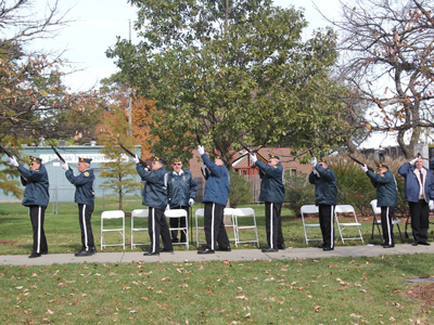 Twenty-one gun salute by the rifle team from Olathe American Legion Post 153, under direction of Karl Nelson